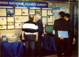Conference attendees discussing our exhibit